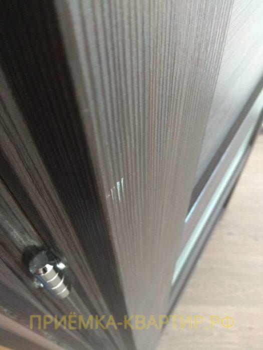 Приёмка квартиры в ЖК Семь Столиц: Сколы на ламинации дверной коробки